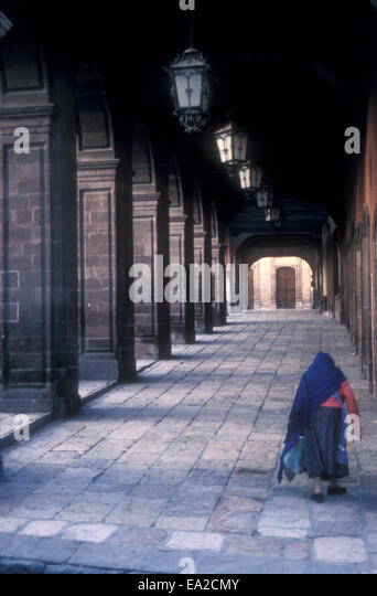 bent-over-old-mexican-woman-walking-unde