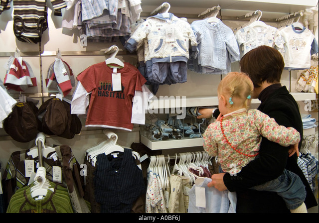 mother and child shopping for childrens clothes england uk a0bf6j childrens clothes shop stock photos & childrens clothes shop stock,Childrens Clothes Retailers Uk