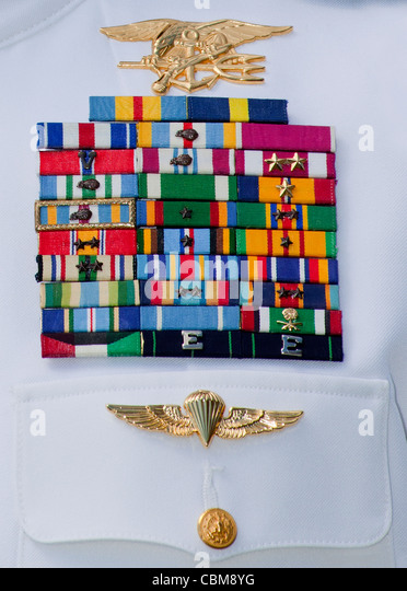 close up view of military decorations and honors on an admirals dress white uniform - Military Decorations