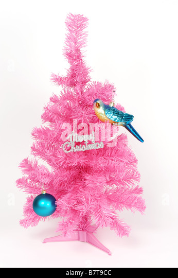 pink plastic christmas tree with shiny bauble bird decoration and merry christmas sign - Plastic Christmas Tree