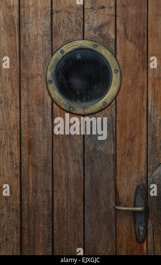 Wooden door with porthole of a ship - Stock Image & Door Porthole Window Stock Photos \u0026 Door Porthole Window Stock ...