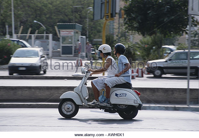 Boys Riding Scooters Stock Photos & Boys Riding Scooters ...