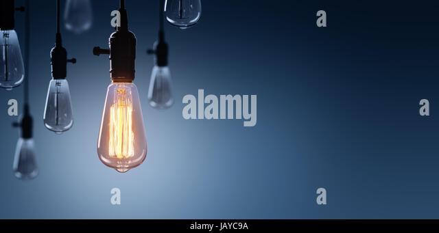 Innovation And Leadership Concept - Glowing Bulb On Among Bulbs Off - Stock Image