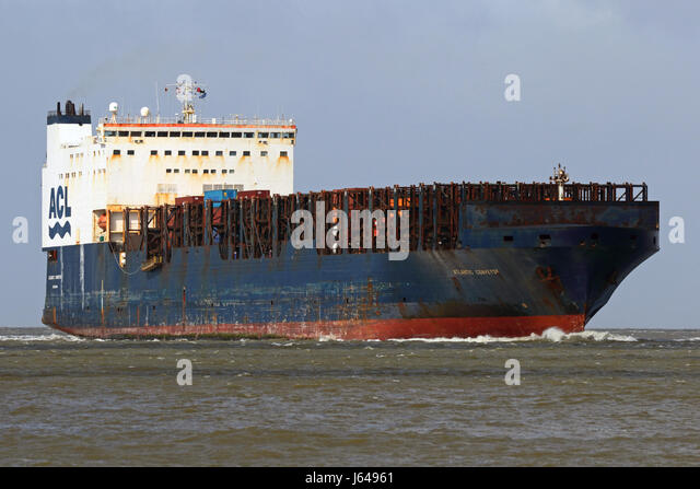 The conro ship Atlantic Conveyor passes the port of Cuxhaven on the Elbe. - Stock Image