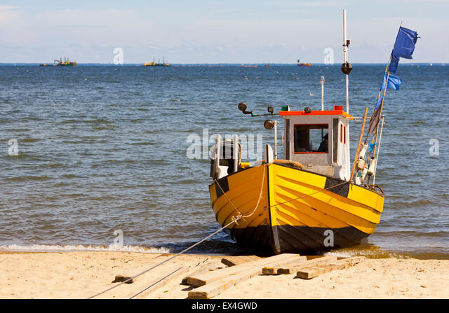 Small wooden motor boat on stock photos small wooden for Small fishing boats with motor