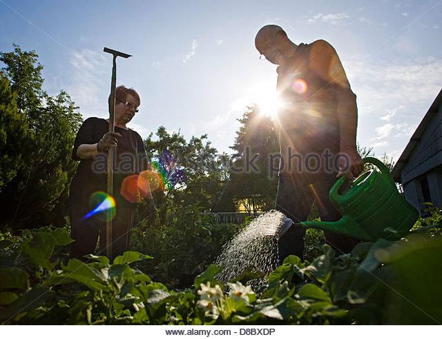 Couple Holding Gardening Equipment Stock Photos Amp Couple