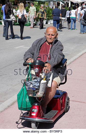 Electric wheelchair cart stock photos electric for Motorized cart for seniors