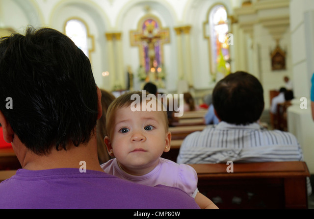 catholic mass hispanic stock photos catholic mass. Black Bedroom Furniture Sets. Home Design Ideas