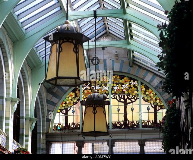Art nouveau stock photos art nouveau stock images alamy art nouveau lamp shades and stained glass window inside the royal arcade norwich city centre aloadofball Gallery