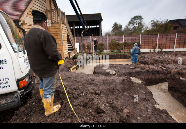 Tamping stock photos tamping stock images alamy for Poured foundation