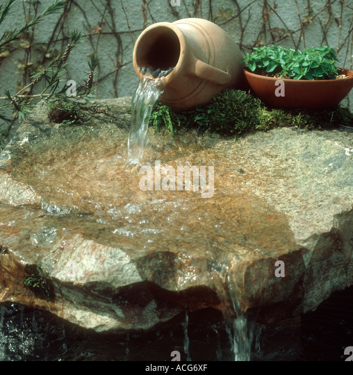 Garden pond and water feature stock photos garden pond for Ornamental garden features
