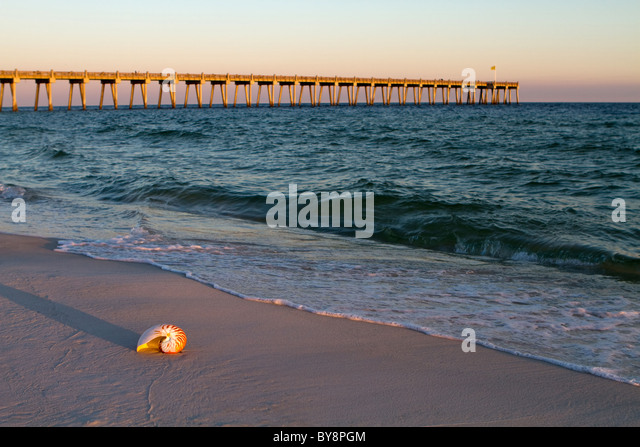 Fishing on beach at sunset mexico stock photos fishing for Fishing piers in biloxi ms