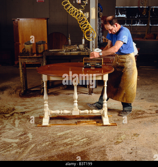 WORKER DOES THE FINAL POLISHING TO A PIECE OF FURNITURE, PENNSYLVANIA HOUSE  FURNITURE COMPANY,