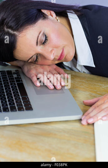businesswoman taking a nap on her desk stock image business nap office relieve
