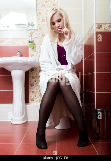 Young Woman Sitting On Toilet Stock Photos & Young Woman