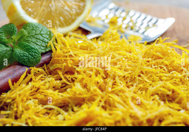 Fragrant lemon zest grated close up. - Stock Image