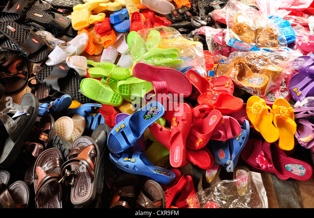 Of cloths and sandals for sale across the road in hai phong vietnam