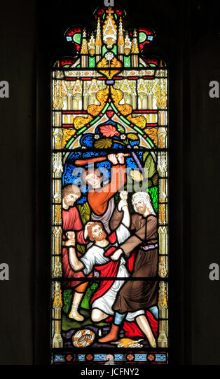 Parable of The Good Samaritan, stained glass window by Frederick Preedy, 1865, Traveller beaten and robbed by thieves, - Stock Image