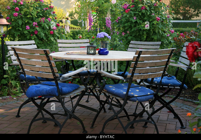 Terrace flower chairs stock photos terrace flower chairs for Garden pool ystad