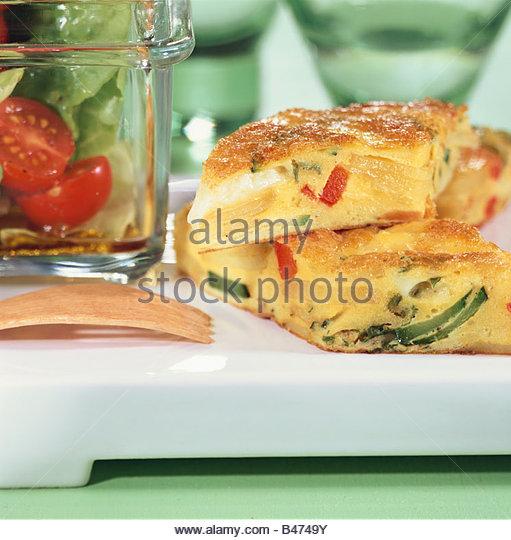 Potato and vegetable frittata - Stock Image