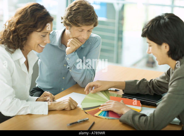 Mature professional couple having appointment with interior decorator -  Stock Image