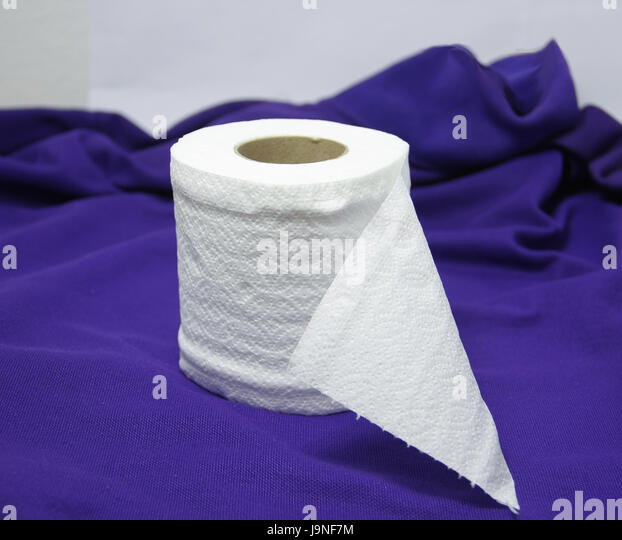 Roll Fresh Tissue On Purple Cloth For Convenience