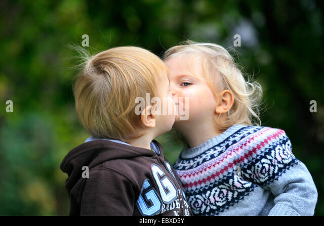 Little boy and girl kissing stock photos little boy and girl little boy and little girl kissing stock image altavistaventures Images