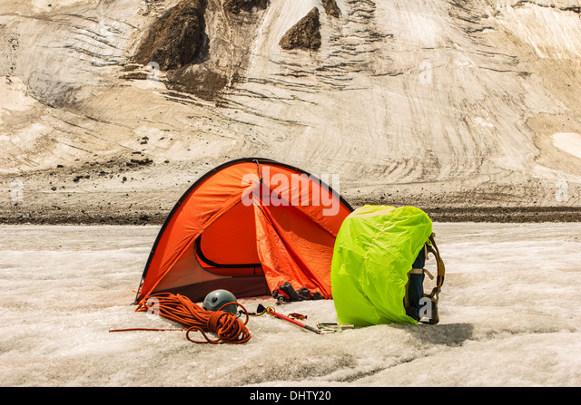 The red tent costs on glacier - Stock Image & Orange Camping Tent On Mountain Stock Photos u0026 Orange Camping Tent ...