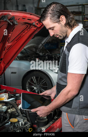 Happy car mechanic tablet pc stock photos happy car for Garage happy car