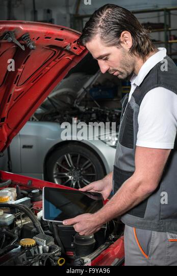 Happy car mechanic tablet pc stock photos happy car for Garage happy car