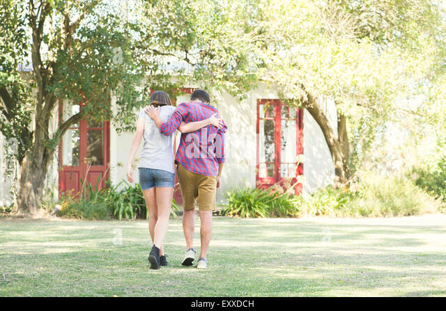 Couple Arm Shoulder Walking Stock Photos & Couple Arm ...