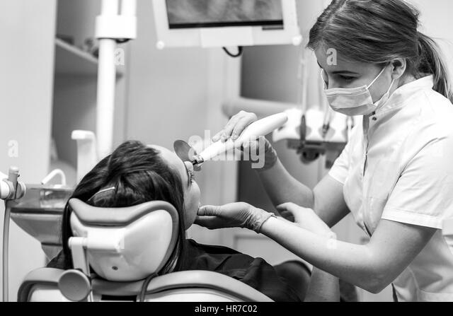 Black And White Close Up View Of Female Patient At The Dentist Making Dental Fillings With