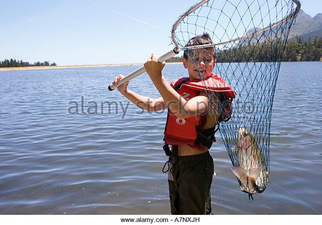 Boys catching fish stock photos boys catching fish stock for People catching fish