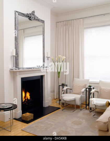 White Mirror Above White Fireplace Stock Photos & White Mirror ...