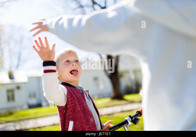 Victory blow with hands, brother, - Stock Image