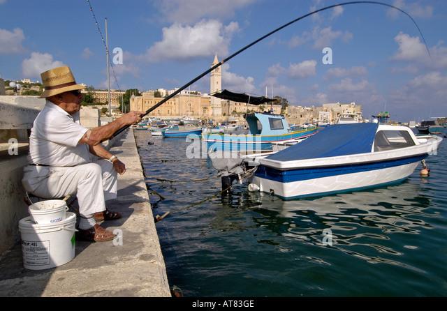 Maltese people fishing jetty stock photos maltese people for Videos of people fishing