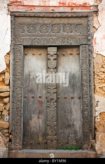 The beautifully carved wooden door frame of a derelict house in Bagamoyo s main street. & Carved Door Frame Stock Photos \u0026 Carved Door Frame Stock Images - Alamy