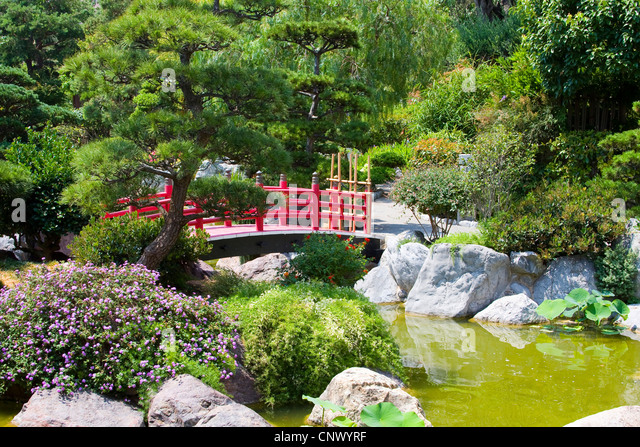 traditional japanese garden with wooden red bridge france monaco stock image