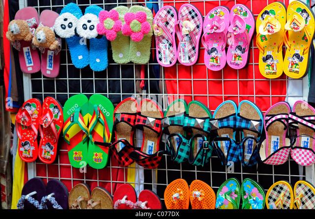 designer flip flops qbc5  fake designer pirate pirated luxury goods on sale stall petaling street  chinatown kuala lumpur malaysia footwear