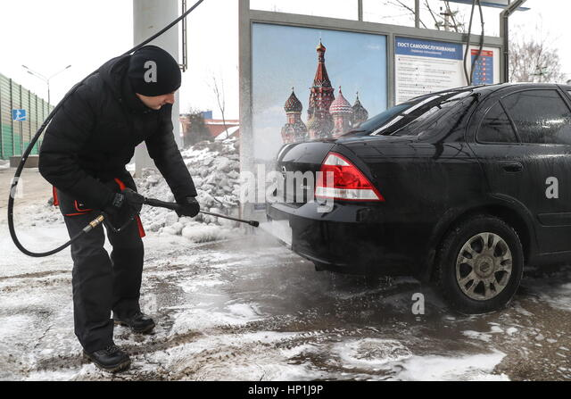Self serve car wash stock photos self serve car wash stock a man washes his vehicle at a solutioingenieria Image collections