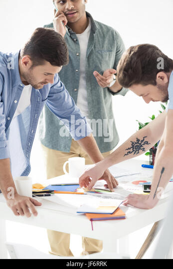 casual businessmen working on new project at modern office, business teamwork - Stock Image