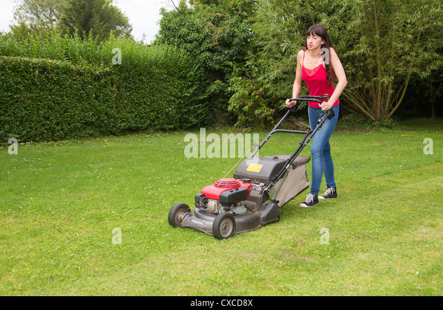 Lawn mowing stock photos lawn mowing stock images alamy for Lawn mower cutting grass
