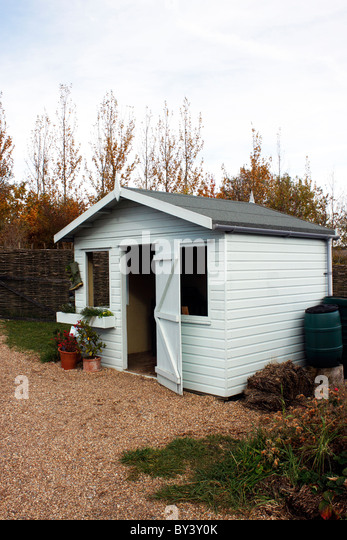 a garden shed in an english garden rhs hyde hall essex uk stock