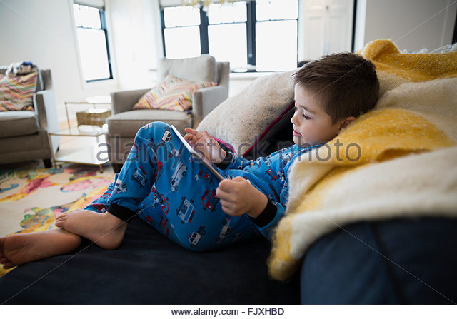 5 Years Stock Photos amp 5 Years Stock Images Alamy : boy in pajamas using digital tablet on sofa fjxhbd from www.alamy.com size 640 x 447 jpeg 66kB