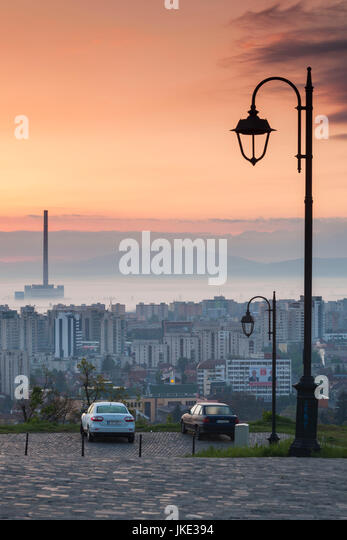 Romania, Transylvania, Brasov, new city and CET Brasov thermal energy plant, dawn - Stock Image