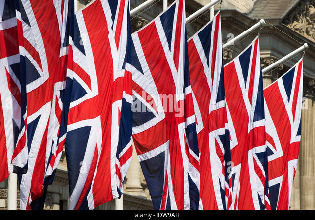 British Union Jack flags hang in Parliament Square, London, ahead of the Queen's speech - Stock Image