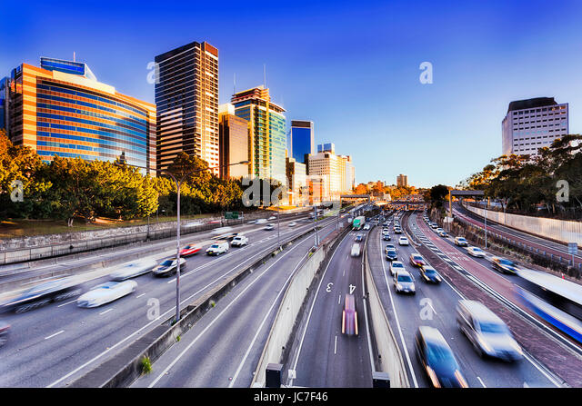 Morning speeding traffic on Warringah freeway goint throug North Sydney during rush hour. Multi-late highway with - Stock Image