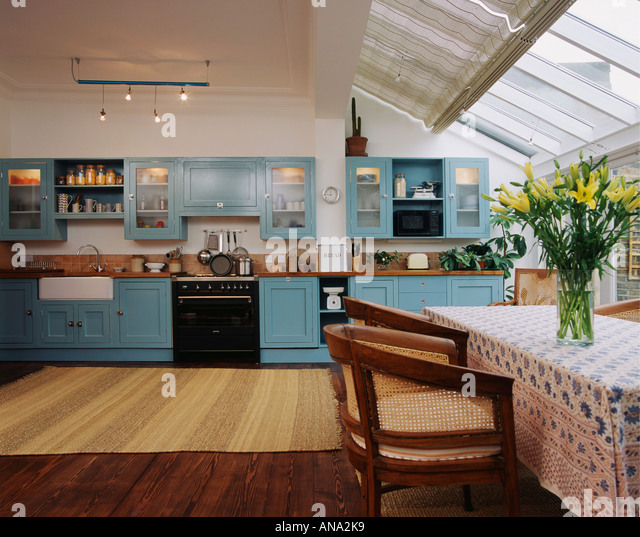 Glass Roof And Wooden Flooring In Spacious Openplan Kitchen Dining Room Extension With Turquoise Fitted