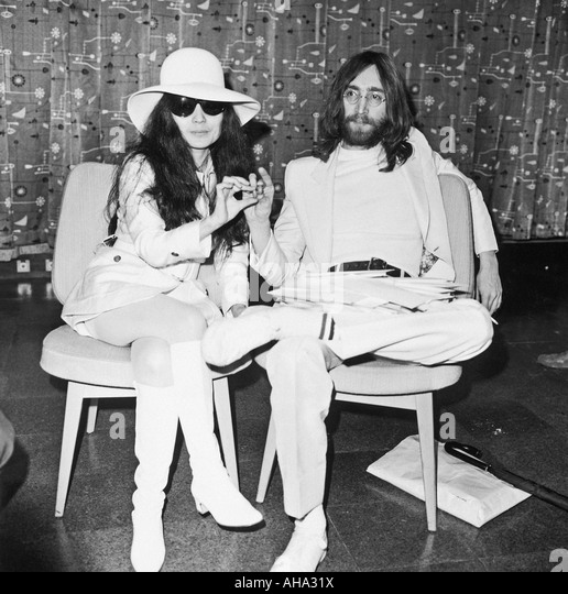 Beatles john and yoko return to london after the european publicity