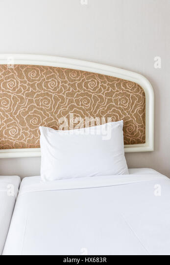 The Clean Bedroom. Soft White Pillow On The Large Bed Of The Clean ...